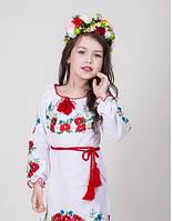 Детское вышитое платье на белом полотне