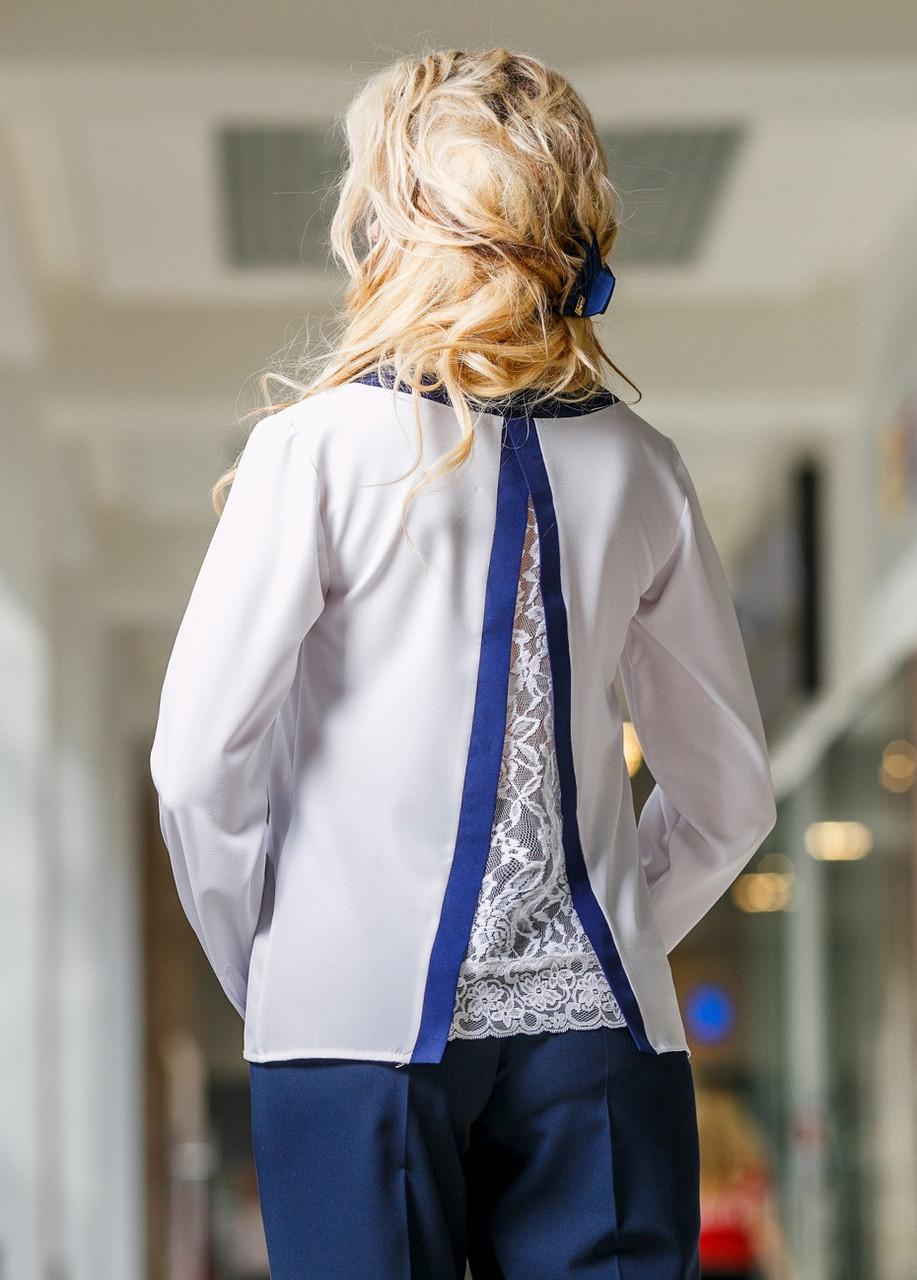 Оригинальная женская блуза с красивой спинкой