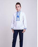 Вышитая сорочка на мальчика синим узором
