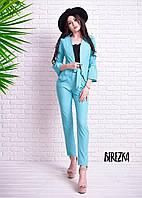 Красивый женский костюм пиджак и брюки в голубом цвете