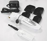 Машинка для стрижки Кеmei-6688, белый, сменный аккумулятор (один), сетевой адаптер,  масло, щеточка, насадки - 4 шт (8, 12, 16, 20 мм), безшумный