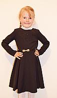 Модное платье для школы черного цвета с клешной юбкой