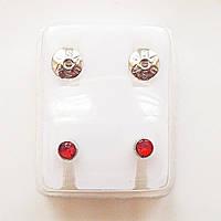 Серьги - иглы для прокола ушей с красными кристаллами.