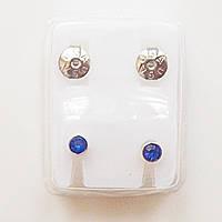 Серьги - иглы для прокола ушей с синими кристаллами.