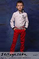 Стильные детские льняные брюки коралл