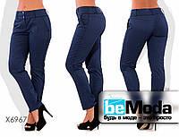 Стильные женские брюки облегающего кроя больших размеров синие