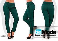 Модные женские брюки облегающего кроя больших размеров зеленые