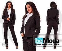 Классический женский брючный костюм оригинального фасона черный