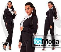 Модный женский брючный костюм оригинального кроя черный
