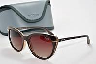 Солнцезащитные очки круглые Vogue коричневые