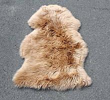 Шкура золотого кольору, килимки в дитячу зі шкур