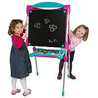 Двухсторонний мольберт Smoby 410102 (Смоби)  Рекомендовано детям от 3-х лет. К мольберту крепится полочка с от