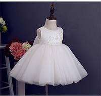 Детское нарядное белое платье с бантом
