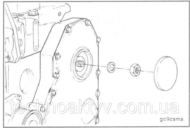 Для обеспечения доступа к шестерне снимите заглушку отверстия в крышке распределительных шестерен.  Снимите гайку и шайбу с вала топливного насоса.