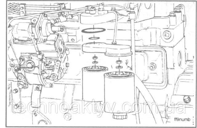 Ключ 24 мм  Отверните стопорную гайку, снимите переходник головки фильтра и уплотнительные шайбы.  Сборку выполняйте в обратном порядке.  Крутящий момент затяжки:32 Н • м [24 ft-lb]