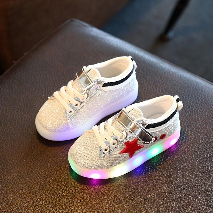 Кросівки оптом світять