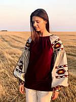 Жіноча оригінальна блузка на велюрі червоного кольору з вишитими рукавами