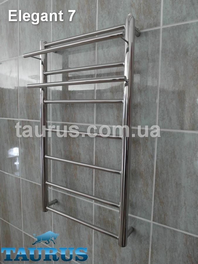 Нержавеющий полотенцесушитель с полочкой Elegant 7/750x400 мм для общей и автономной системы отопления.