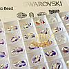 Бусина Сваровски 5728 Crystal AB 12х8,5мм *1шт