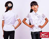 Красивая блузка с коротким рукавом и украшеным передом