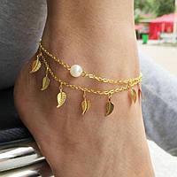 Золотистый браслет с подвесками на ногу