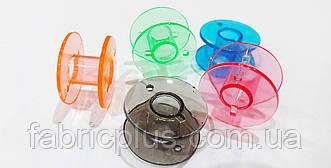 Шпулька пластик к бытовым машинам h=10 мм  цветная