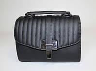 Маленькая женская каркасная сумочка