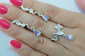 Набор серебряных украшений - кольцо и серьги