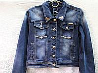 Женский джинсовый пиджак с потертостями