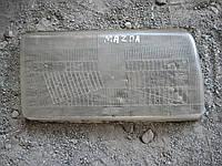 Стекло фара Мазда Mazda
