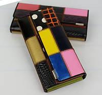 Красивый разноцветный кошелек из натуральной кожи.