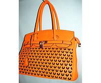 Красивая модная сумка с перфорацией оранжевого цвета