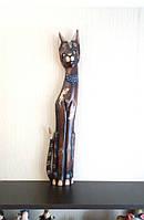Кошечка коричневая с орнаментом ящериц (высота 80 см).