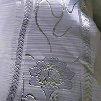 Тюль белая с серебрянным люрексовым цветком.