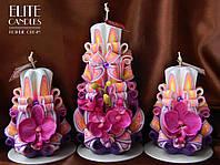 Свечи  в фиолетовом цвете с орхидеями