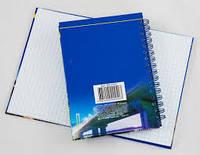 Книга канцелярская А4 ламинированная обложка 120 листов на боковой спирали