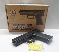 Металлический пистолет с пульками