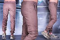 Мужские брюки на манжетах с резинкой и накладными карманами сбоку