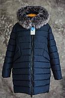 Женская куртка с натуральной опушкой больших размеров.