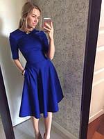Женское расклешенное платье с карманами