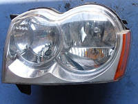 Фара передняя левая электр коректор -08JeepGrand Cherokee III2005-201055156671AI  Valeo