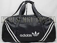 Большая черная дорожная сумка из плотной ткани