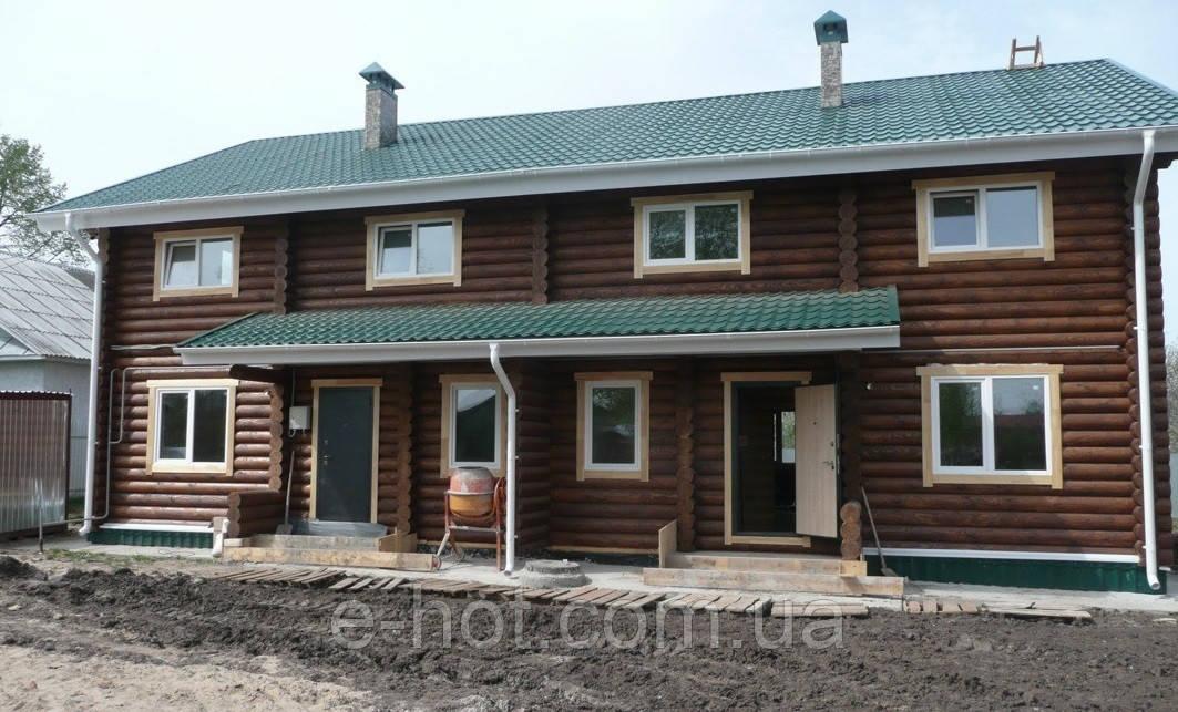 Строительство многоквартирного дома из оцилиндрованного бревна