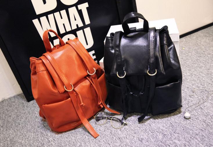 Вместительный городской лакированный рюкзак