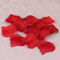 Лепестки красной розы искусственные.