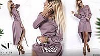 Шикарный костюм состоящий из блузки и юбки со шлейфом.