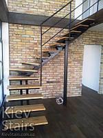 Отделка деревом металлокаркаса лестницы в стиле Лофт