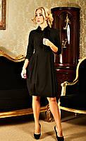 Классическое платье исполнено в черном цвете