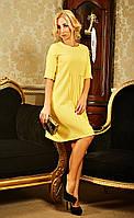 Яркое желтое платье оригинального дизайна