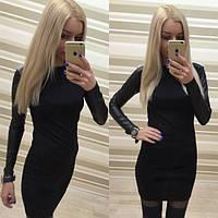 Женское красивое платье с кожаными рукавами и шипами